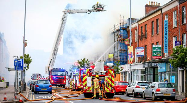 Firefighters deal with a major fire in the Great Victoria Street area of Belfast on the 11th September 2016 ( Photo by Kevin Scott / Presseye )