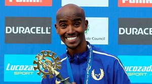 Mo Farah celebrated a third successive Great North Run win yesterday