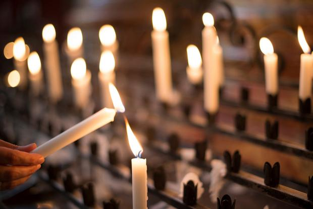 Shedding light: each candle marks an earnest prayer for help