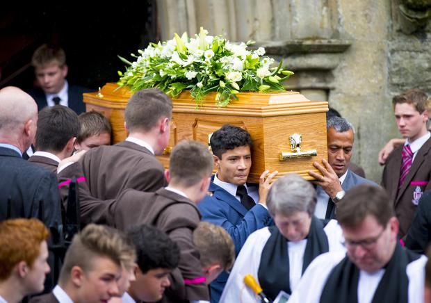 Brother Jono and Father Abraham carry the coffin at funeral of the Royal School Dungannon pupil David Shrestha in Dungannon. ( Photo by Kevin Scott / Belfast Telegraph )