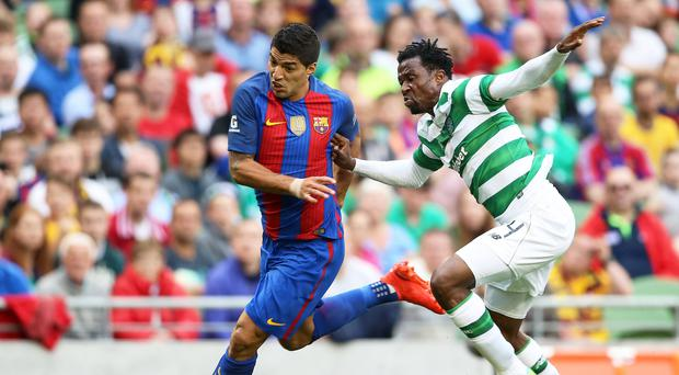 Different class: Luis Suarez gets away from Efe Ambrose in Barcelona's 3-1 win over Celtic in Dublin in July