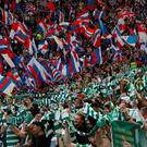 Bitter rivals: Fans at Saturday's controversial Old Firm clash at Parkhead