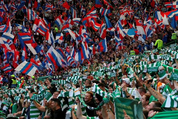 Celtic and Rangers fans show their support during the Ladbrokes Scottish Premiership match at Celtic Park, Glasgow. PRESS ASSOCIATION Photo. Picture date: Saturday September 10, 2016. See PA story SOCCER Celtic. Photo credit should read: Andrew Milligan/PA Wire. EDITORIAL USE ONLY