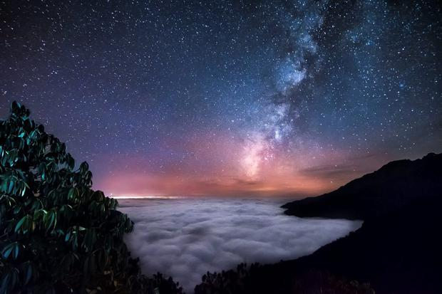 Milky way above the clouds ocean by Yevhen Samuchenko which was entered into this year's Royal Photographic Society's International Images for Science competition.