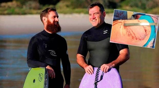 Best friends Shane De Roiste (left) and Dale Carr were surfing 200m from shore when a great white latched on to Dales thigh and buttocks