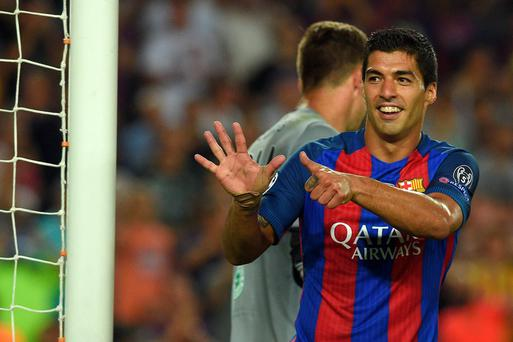Barcelona's Uruguayan forward Luis Suarez gestures after scoring a goal during the UEFA Champions League football match FC Barcelona vs Celtic FC at the Camp Nou stadium in Barcelona on September 13, 2016. AFP/Getty Images