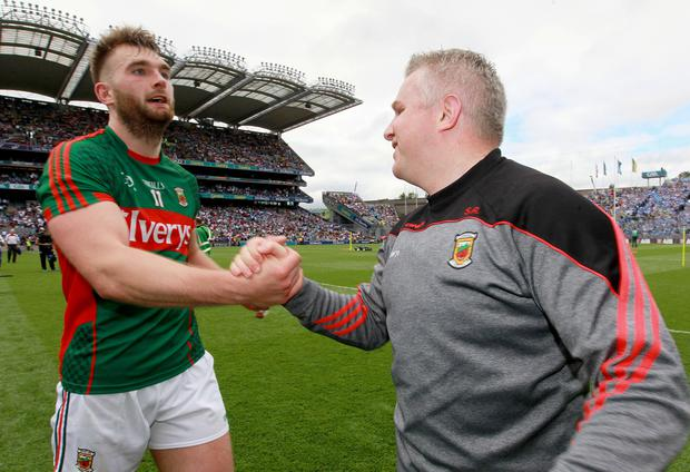 On the rise: Mayo's Aidan O'Shea and Stephen Rochford celebrate victory over Tyrone in the quarter-final