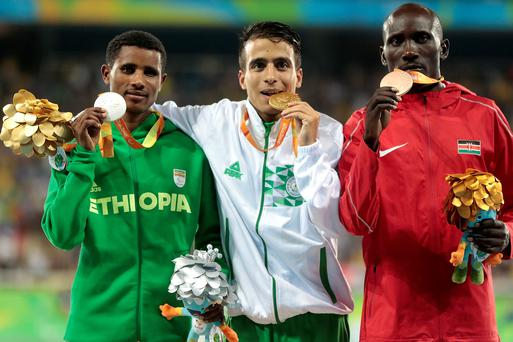 Fast track: (From left) silver medallist Tamiru Demisse of Ethiopia, gold medallist Abdellatif Baka of Algeria and bronze medallist Henry Kirwa of Kenya produced 1,500m times good enough to have won gold at last month's Olympics