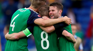 History boys: Northern Ireland aces Gareth McAuley, Steven Davis and Oliver Norwood celebrate the 2-0 triumph over Ukraine at the Euro 2016 finals