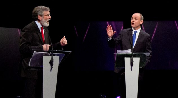 Renewing rivalries: A new battleground between Fianna Fail and Sinn Fein will open up after Micheal Martin (right) announced he intends to make his party a political force in Northern Ireland