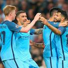 Sergio Aguero of Manchester City celebrates with team-mates after scoring his second during the UEFA Champions League match between Manchester City FC and VfL Borussia Moenchengladbach at Etihad Stadium on September 14, 2016 in Manchester, England. (Photo by Alex Livesey/Getty Images)
