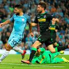 Three and easy: Sergio Aguero completes his hat-trick after skipping past Moenchengladbach goalkeeper Yann Sommer