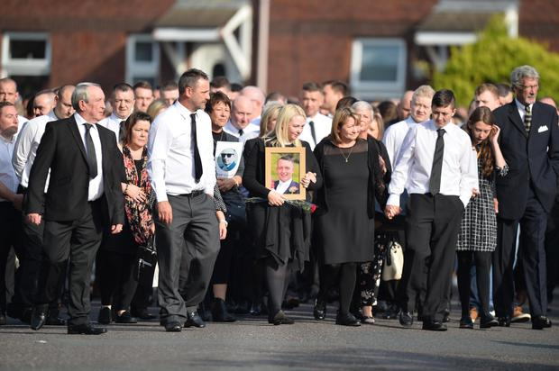 Family and friends during the funeral of Gerard McMahon at St Matthew's Church in Belfast on Thursday. Picture Colm Lenaghan/ Pacemaker