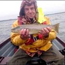 Top catch: Northern Ireland angler Peter Neeson endured rough conditions but was able to boat this beautiful Lough Sheelin trout
