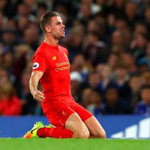 Jordan Henderson of Liverpool celebrates scoring his sides second goal during the Premier League match between Chelsea and Liverpool at Stamford Bridge on September 16, 2016 in London, England. (Photo by Clive Rose/Getty Images)