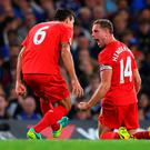 LONDON, ENGLAND - SEPTEMBER 16: Jordan Henderson of Liverpool (14) celebrates with team mates Dejan Lovren as he scores their second goal during the Premier League match between Chelsea and Liverpool at Stamford Bridge on September 16, 2016 in London, England. (Photo by Shaun Botterill/Getty Images)