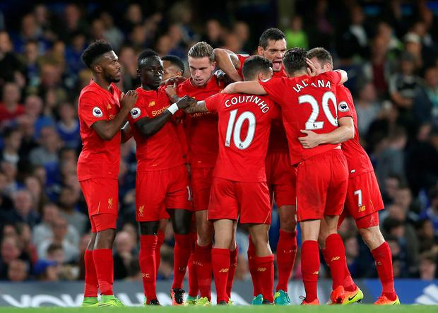 Liverpool's Jordan Henderson (centre) celebrates scoring his side's second goal of the game with teammates during the Premier League match at Stamford Bridge, London. PRESS ASSOCIATION Photo. Picture date: Friday September 16, 2016. See PA story SOCCER Chelsea. Photo credit should read: Scott Heavey/PA Wire. RESTRICTIONS: Editorial use only. Maximum 45 images during a match. No video emulation or promotion as 'live'. No use in games, competitions, merchandise, betting or single club/player services. No use with unofficial audio, video, data, fixtures or club/league logos.