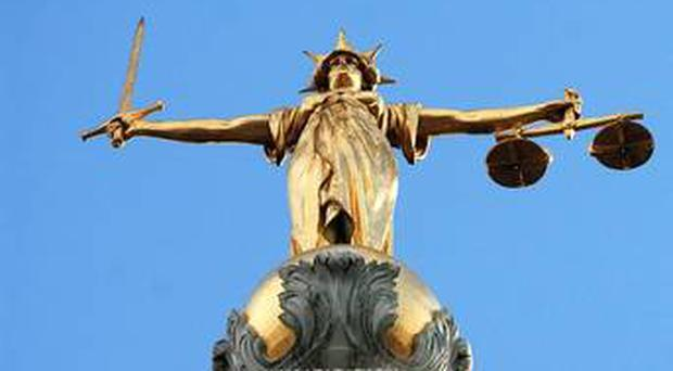 A Belfast grandfather who was caught red-handed growing cannabis plants was given a suspended prison sentence yesterday