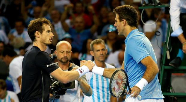 Long service game: Andy Murray (left) and Argentina's Juan Martin del Potro shake hands after their epic battle yesterday