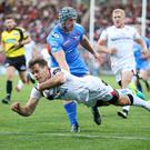 Going over: Louis Ludik takes to the air to bag a try in Ulster's victory over the Scarlets