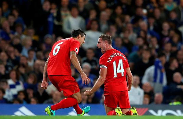 Finishing touch: Liverpool's Jordan Henderson (right) celebrates scoring his side's second goal of the game at Stamford Bridge
