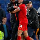 Double act: Jurgen Klopp and Jordan Henderson celebrate at the finish