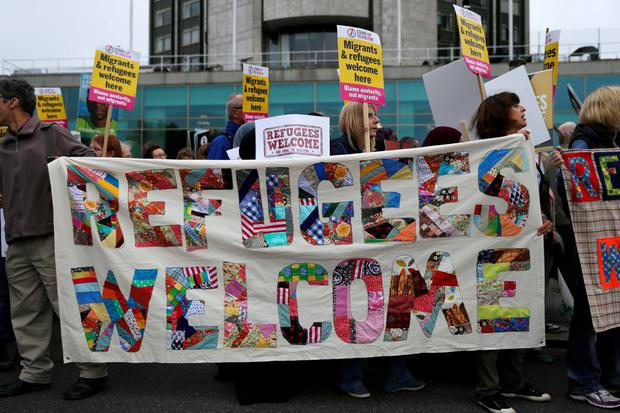 Demonstrators take part in a march calling for the British parliament to welcome refugees in the UK in central London on September 17, 2016. Thousands marched in central London calling on the British government to do more to help refugees fleeing conflict and persecution. / AFP PHOTO / DANIEL LEAL-OLIVASDANIEL LEAL-OLIVAS/AFP/Getty Images