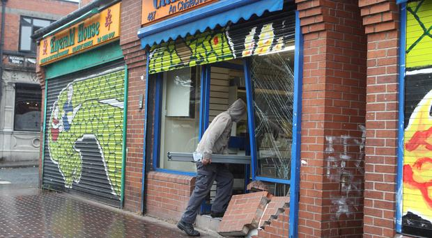 18/9/16 PACEMAKER PRESS Shortly after 7am on Sunday morning, it was reported that a black Ford Ecosport collided with shutters and the shop fronts of a chemist and a bakery. PICTURE MATT BOHILL PACEMAKER PRESS