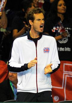 Cheer leader : Andy Murray cheers on Great Britain team-mate Dan Evans in his match against Argentina's Leonardo Mayer at the Emirates Arena in Glasgow... but holders GB eventually lost out