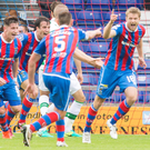 Sting in the tail: Inverness Caledonian Thistle's Alex Fisher celebrates scoring his side's late equaliser against Celtic