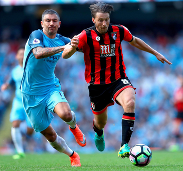 On a great run: Aleksandar Kolarov chases Bournemouth ace Harry Arter at the Etihad Stadium