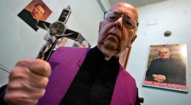 File photo taken on October 10, 2005 shows Don Gabriele Amorth, exorcist in the diocese of Rome and the president of honour of the Association of Exorcists, posing in Rome. AFP/Getty Images