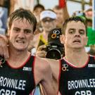 Brothers in arms: British athlete Alistair Brownlee (left) helps his brother Jonathan over the line during the ITU World Triathlon Championships in Cozumel, Mexico