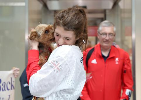 Bethany Firth is greeted by her dog Russell as she arrives at Belfast City Airport. 20th September 2016. Photograph by Declan Roughan. Press Eye