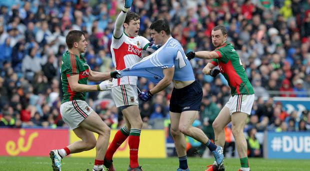 Pulling power: Dublin and Mayo get shirty in the drawn All-Ireland final