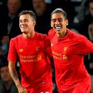 DERBY, ENGLAND - SEPTEMBER 20: Philippe Coutinho (L) of Liverpool celebrates scoring his team's second goal with Roberto Firmino during the EFL Cup Third Round match between Derby County and Liverpool at iPro Stadium on September 20, 2016 in Derby, England. (Photo by Richard Heathcote/Getty Images)