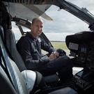 Prince William in the cockpit of an H145 helicopter