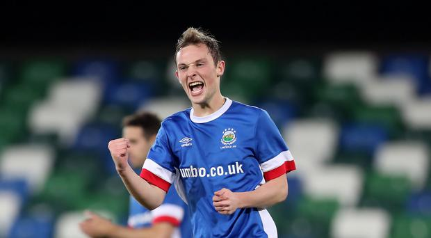 Net gains: Reece Glendinning celebrates opening the scoring for Linfield at Windsor Park