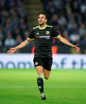 Extra mile: Cesc Fabregas salutes his double