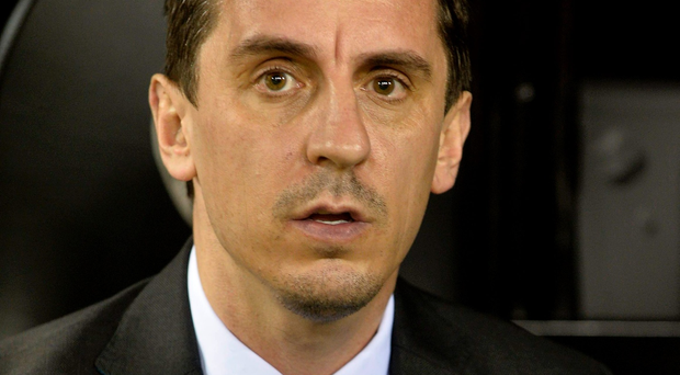 Gary Neville was reacting to the publication of several stories which claim that players are unhappy with the man-management of Jose Mourinho. AFP/Getty Images