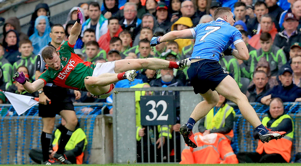 Sitting Boyle: Mayo's Colm Boyle appears to be more Bruce Lee than Geronimo but it's all in a day's work for an Apache warrior