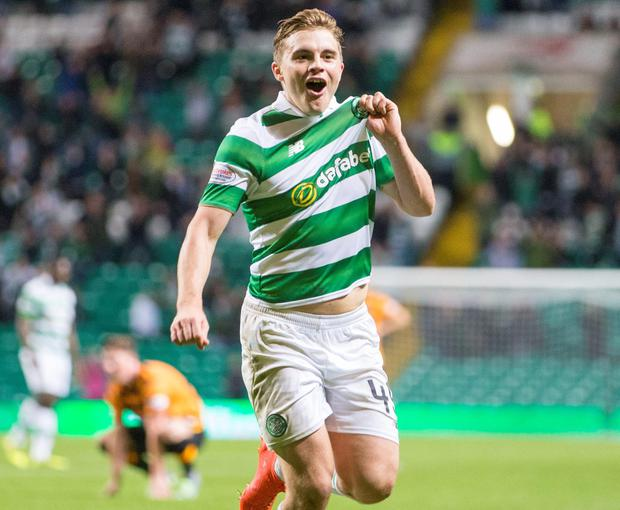 Celtic's James Forrest celebrates scoring his side's first goal against Alloa