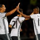 Winning hand: goalscorer Marcus Rashford (right) takes the salute from Zlatan Ibrahimovich as Manchester United moved on to a next round derby clash with rivals City in 3-1 win at Northampton last night