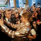 Model Gigi Hadid poses with fans outside Max Mara flagship store during the women's Spring-Summer 2017 fashion event, in Milan, Italy, Wednesday, Sept. 21, 2016. (AP Photo/Luca Bruno).