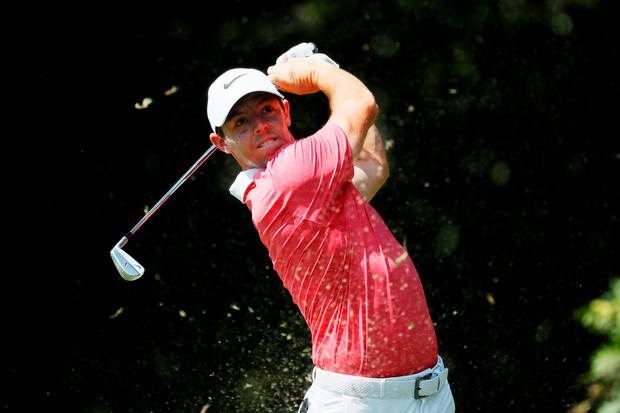 Tee time: Rory McIlroy hits his tee shot on the second in last night's first round of the Tour Championship at East Lake