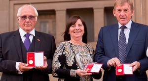 Trevor Hick, Margaret Aspinall and Kenny Dalglish pose with Freedom of the City of Liverpool medals outside St George's Hall on September 22, 2016 in Liverpool, England. (Photo by Richard Stonehouse/Getty Images)