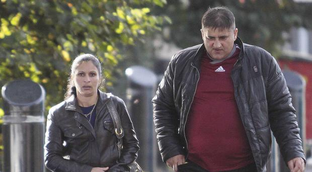 Simona Nicoletta Rostas and her partner Remus Berchi leave Ballymena Magistrates' Court yesterday