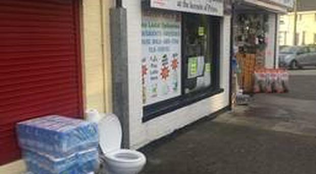 Shop owner Alan Buckley put a toilet and toilet roll outside his shop after the incident