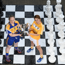 Check mate: Geraldine McManus, left, of Longford and Jenny McCavana of Antrim with the West County Hotel Cup
