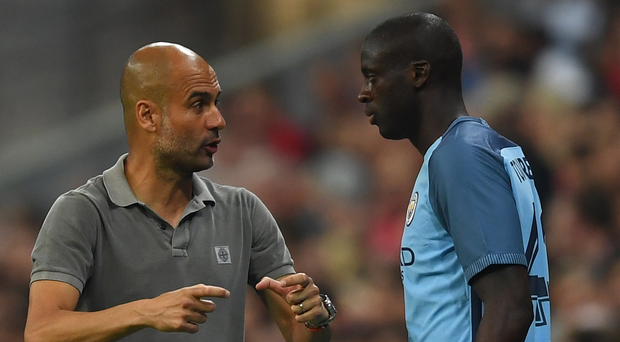 At loggerheads: Man City's Pep Guardiola and Yaya Toure